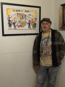 """Toby Zoates with his painting, """"Freedom to Discriminate"""""""