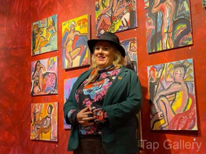"""Anna with her paintings from the """"Painting the Nude"""" classes."""